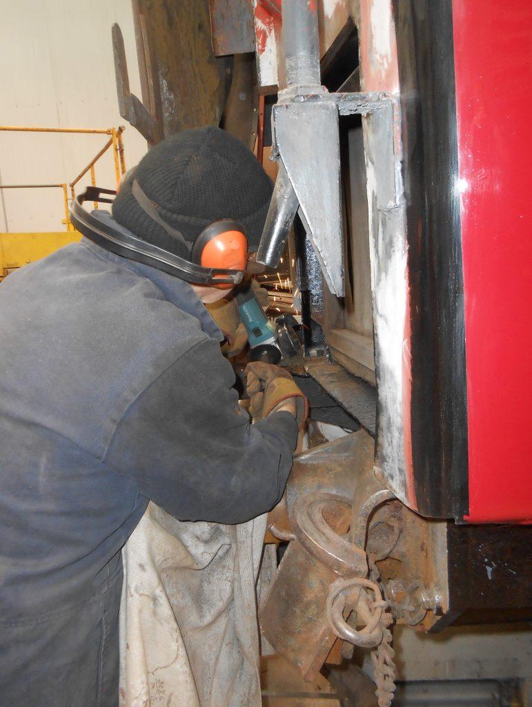 John grinding down weld