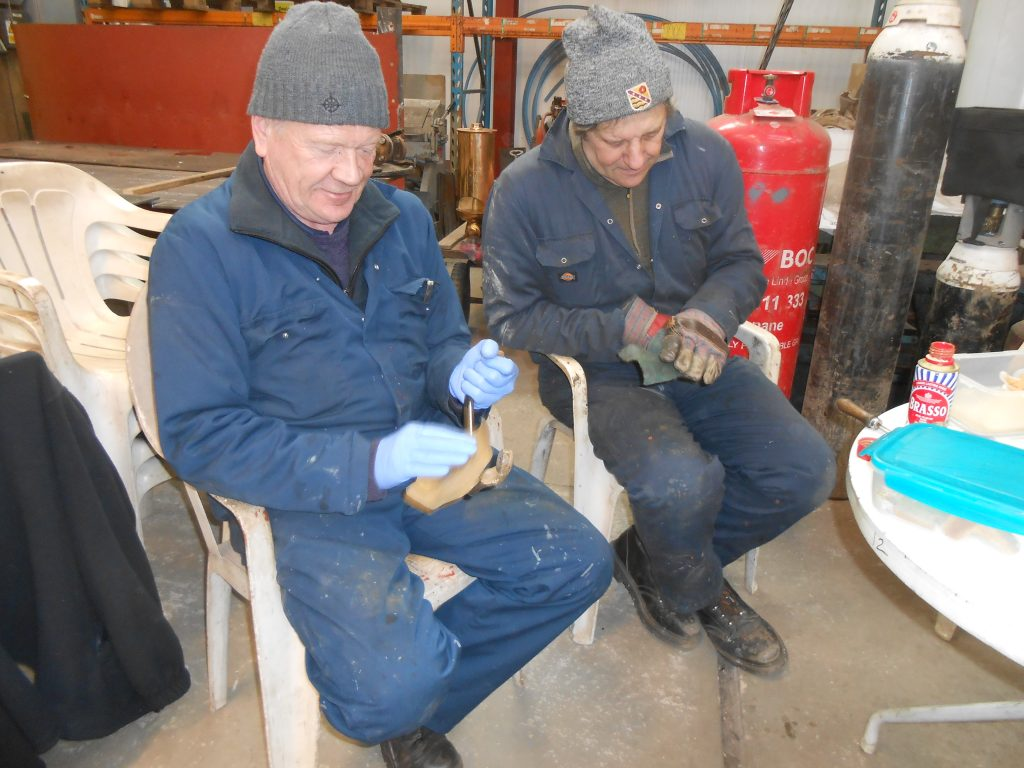 Paul and Mike cleaning brass carriage grab handles