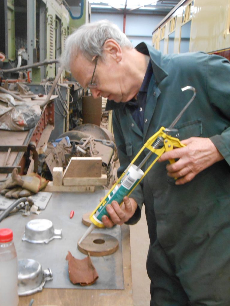 John preparing one of the lighting connector pattresses for fitting