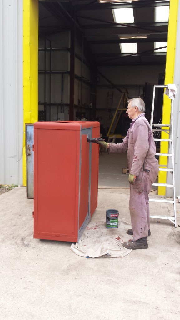 The paint cabinet receiving some, er, paint