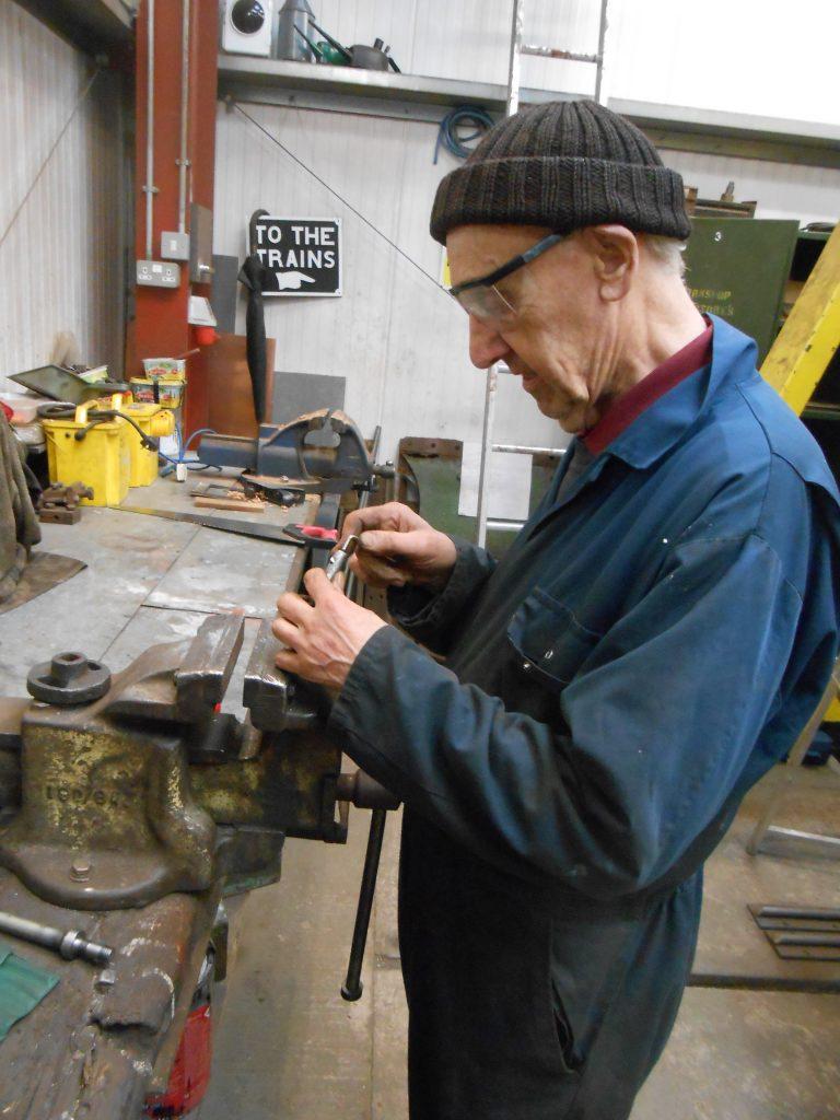 Howard making a square hole