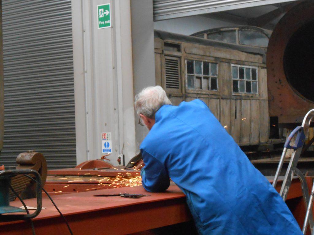 John Houghton grinding off weld on Caliban's running board