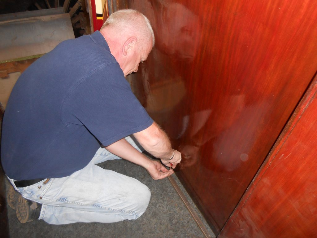 Paul fixing a door runner