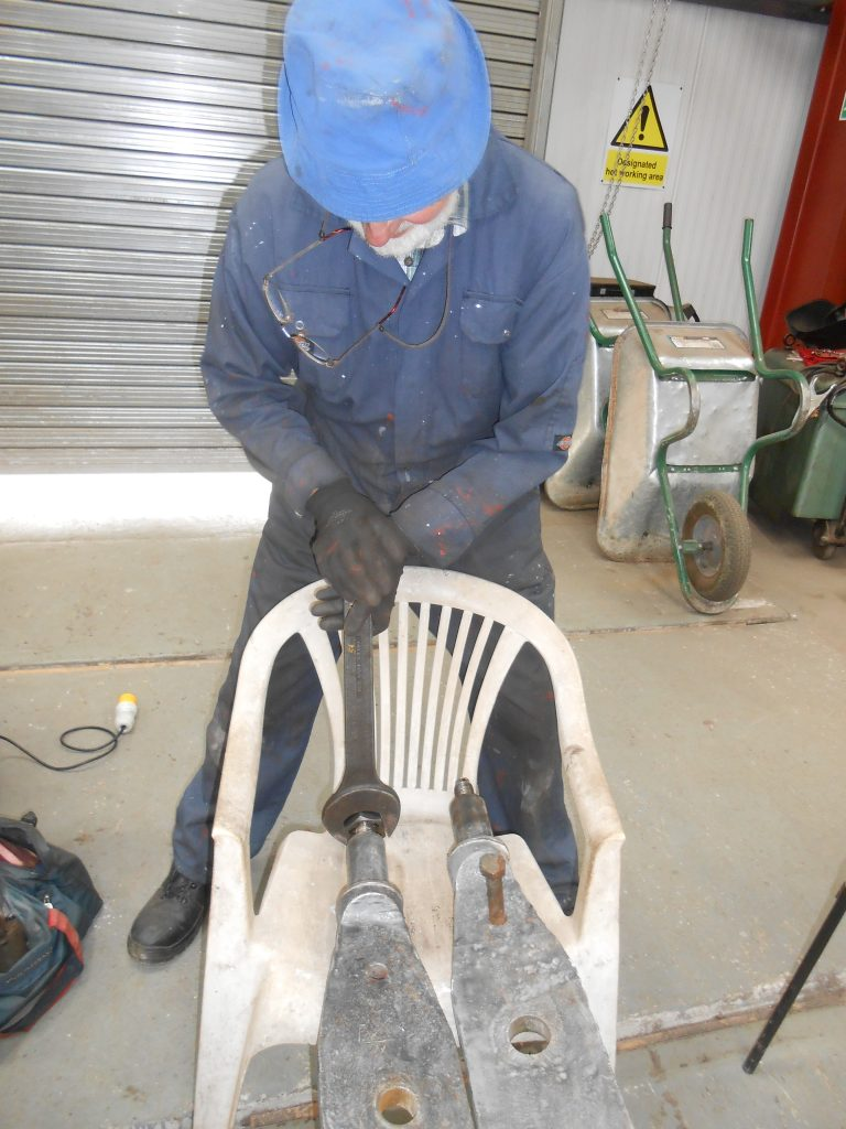 Roger applying a die nut to one of Wootton hall's brake beams