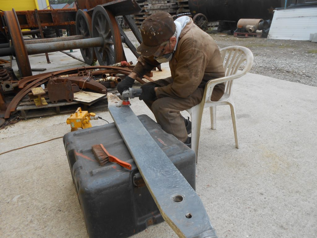 Fred cleaning one of Wootton Hall's brake beams