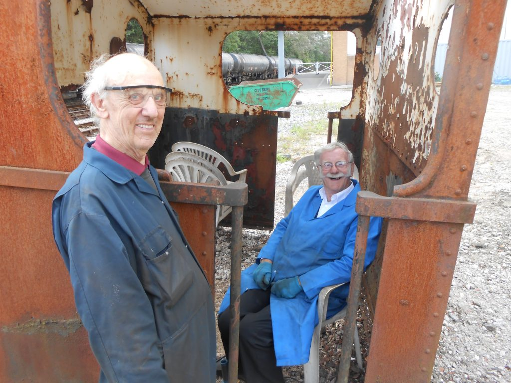 Howard with John H as he takes a break from cleaning Caliban's cab.