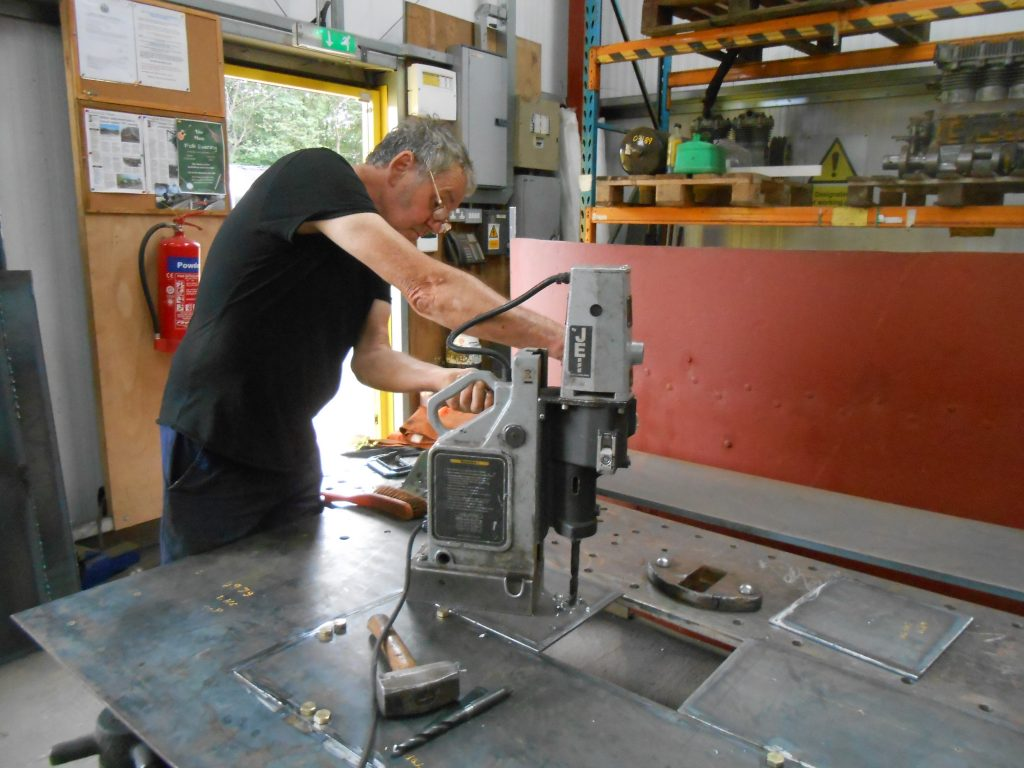 Keith drilling more holes in the new piece of running plate