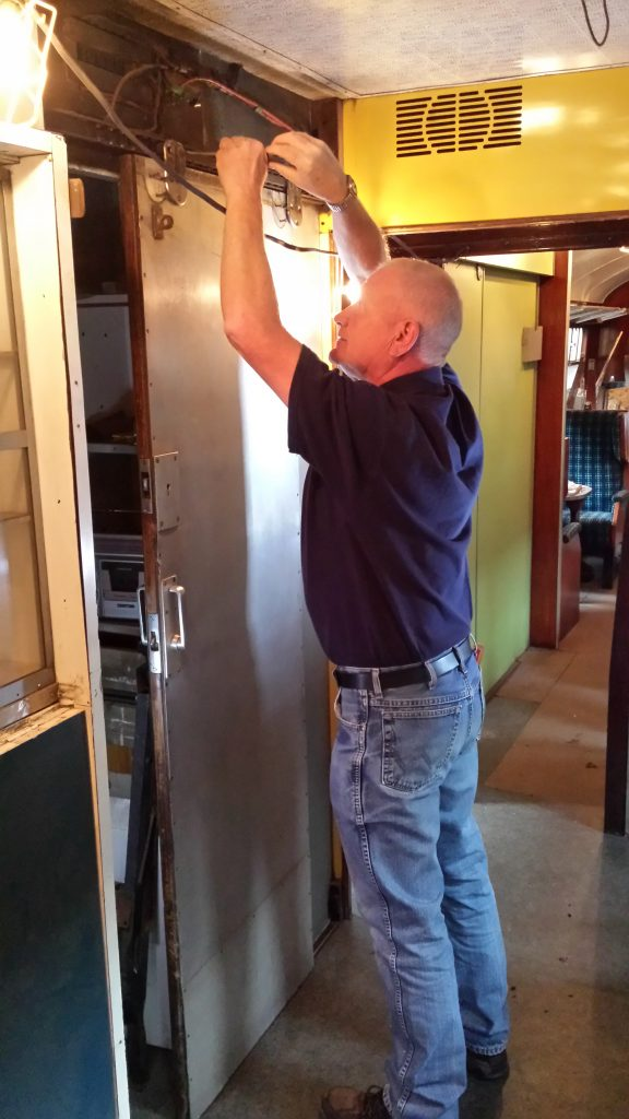 Paul re-installs the buffet counter door