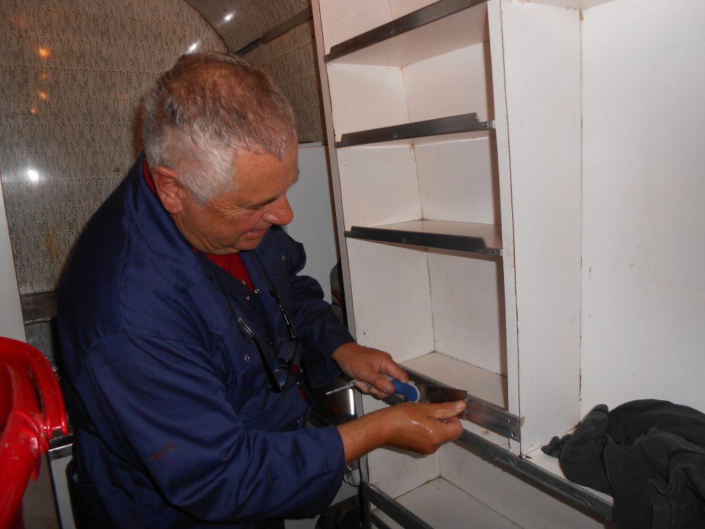 John Davis cleaning the metalwork in the RMB