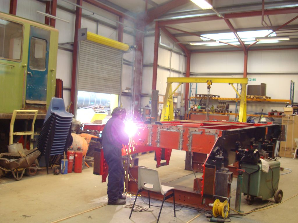 John Stewart welding Wootton Hall's tender frames