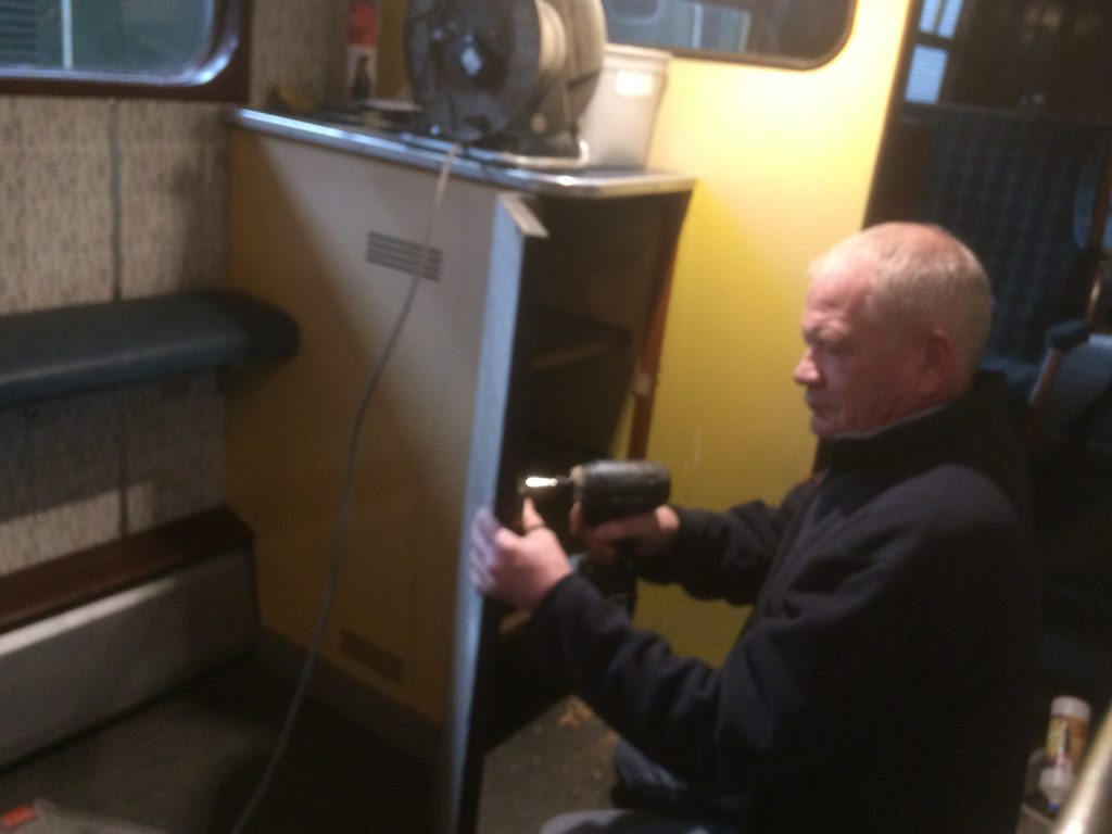 Paul fitting cupboard door locks on the RMN