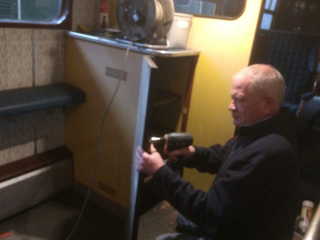 Paul fitting cupboard door locks on the RMN