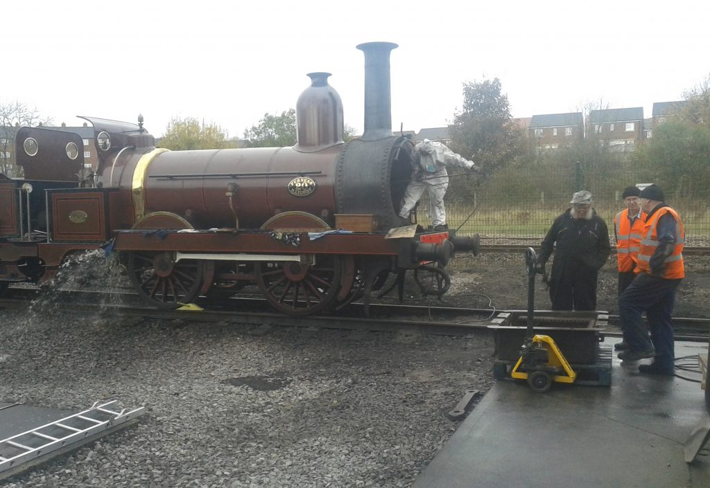 Water is discharged from the boiler as Fred cleans out the tubes