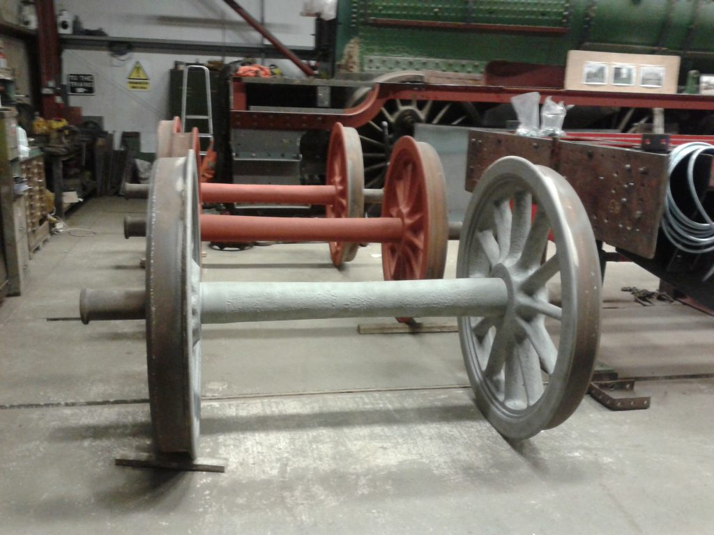 The Hall's tender wheels in the shed after grit blasting with red oxide having been applied to two wheelsets