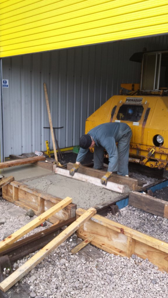 John Dixon levelling off the concrete
