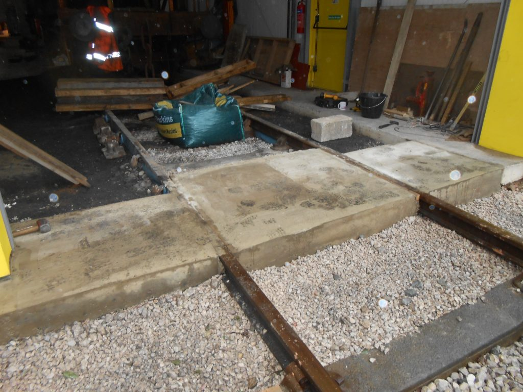 The concrete under the east end shed doors is now complete