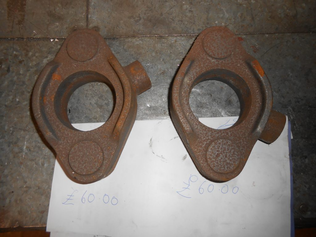 Two new rear valve head cover glands castings - £60 each.