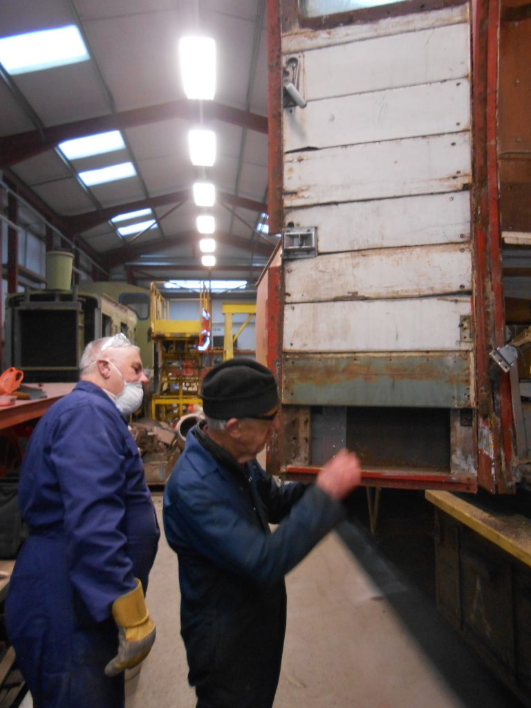 John Davis and Howard Fletcher inspect the RSR's TPO door which requires corrosion repairs