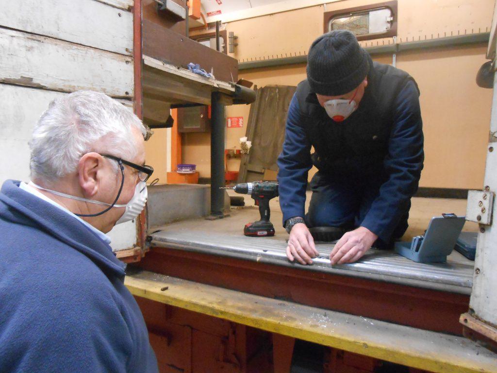 John Davis and Paul working on the TPO's double doors