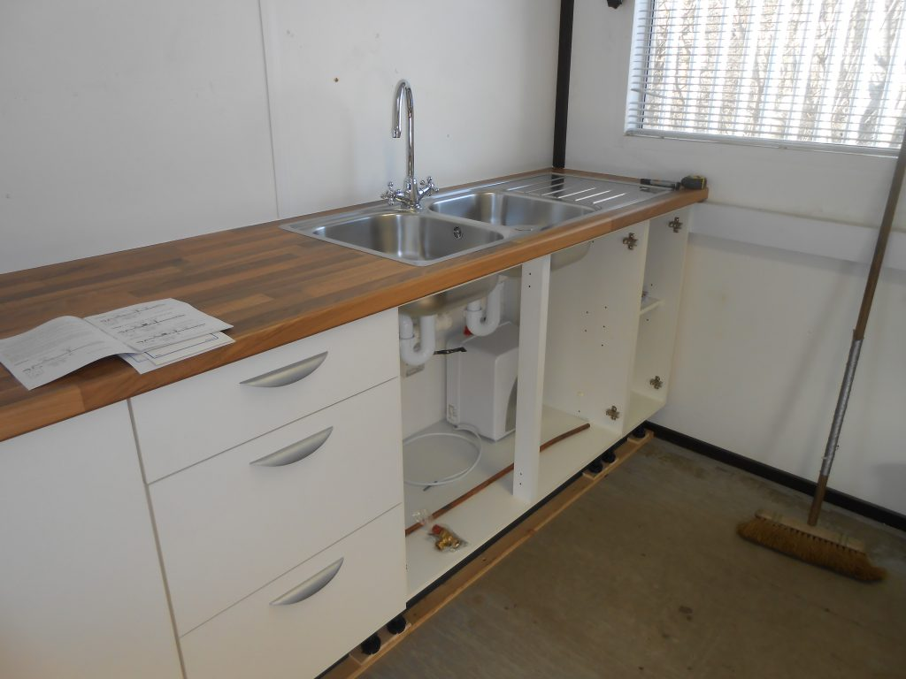 Sink in position and drains connected