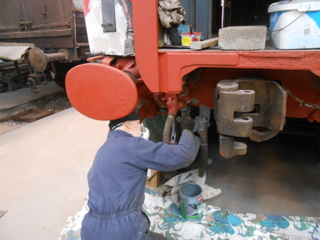Roger Benbow painting the west end headstock on the TPO