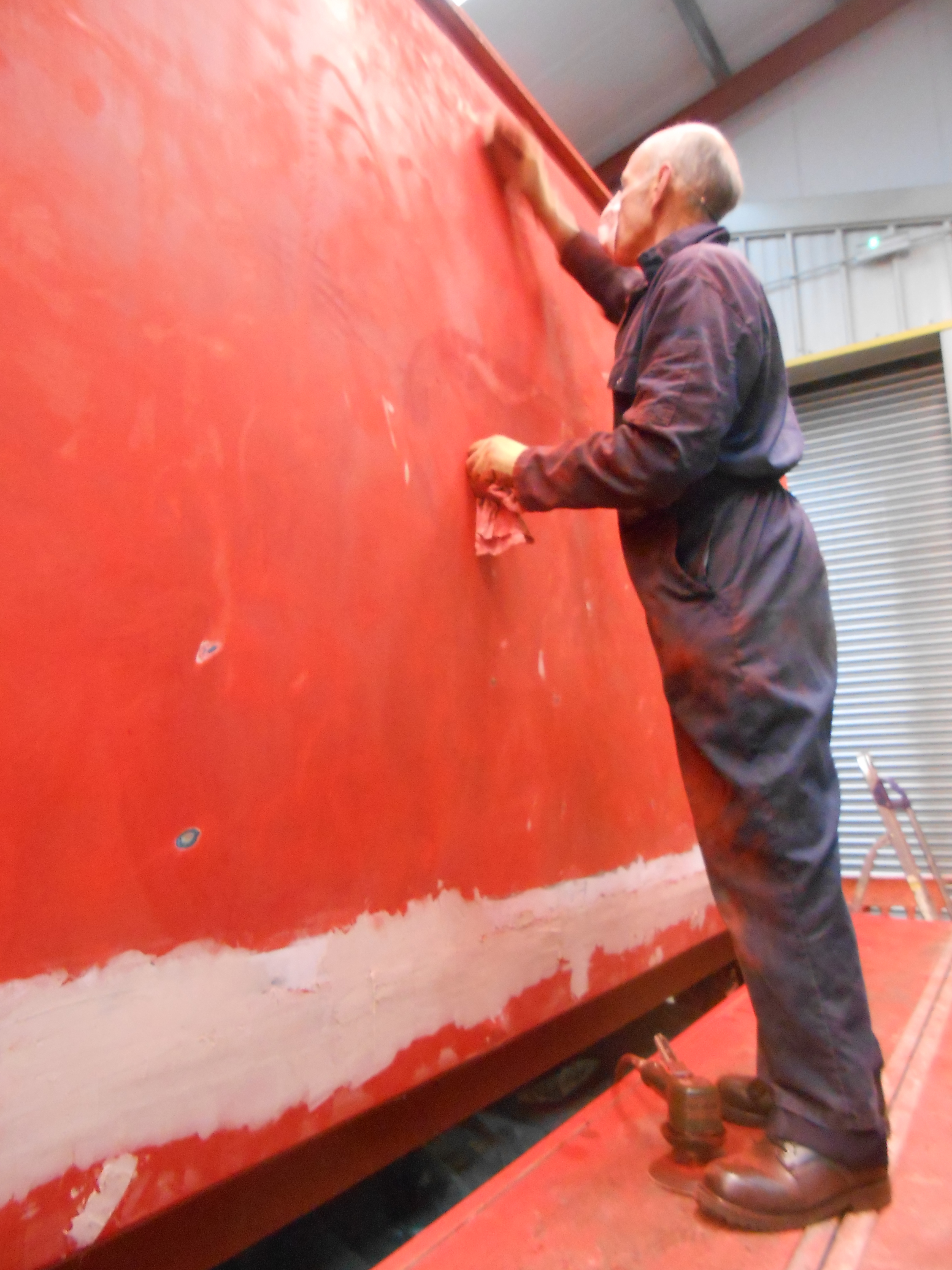 Andy Morton sanding the TPO coach