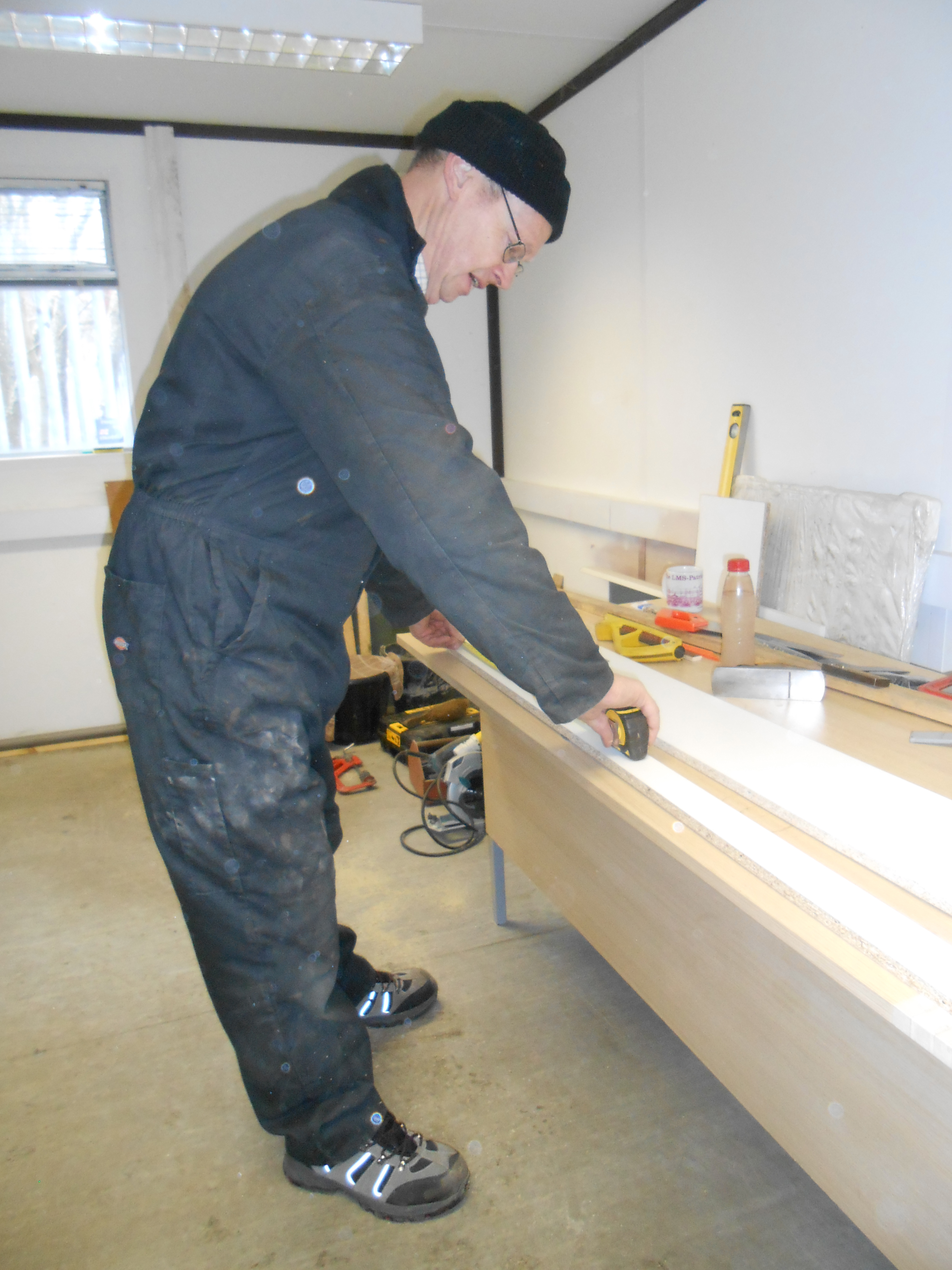 John Dixon measure up the cupboard bottom fascia board