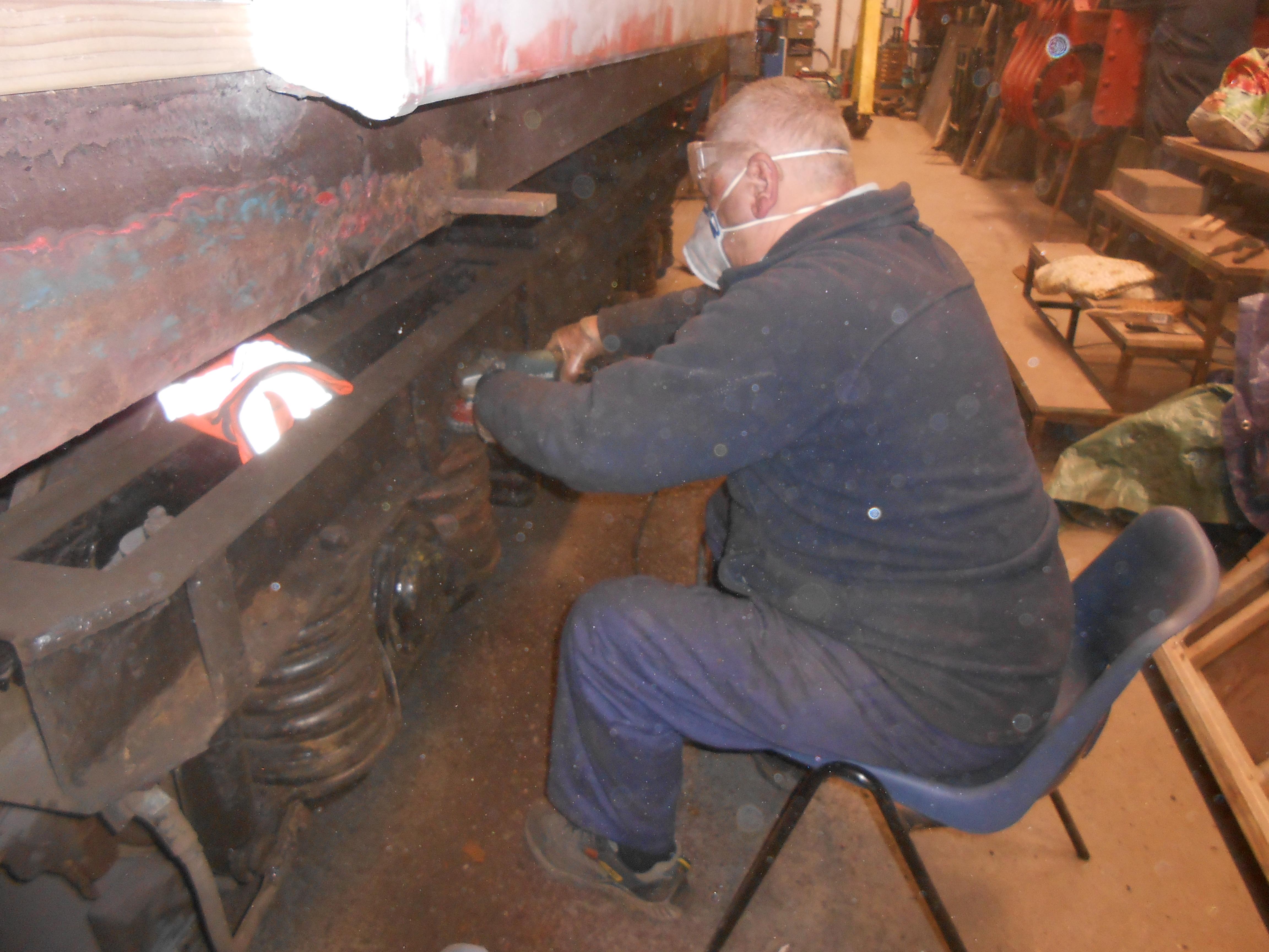 John Davis cleans up a TPO coach bogie