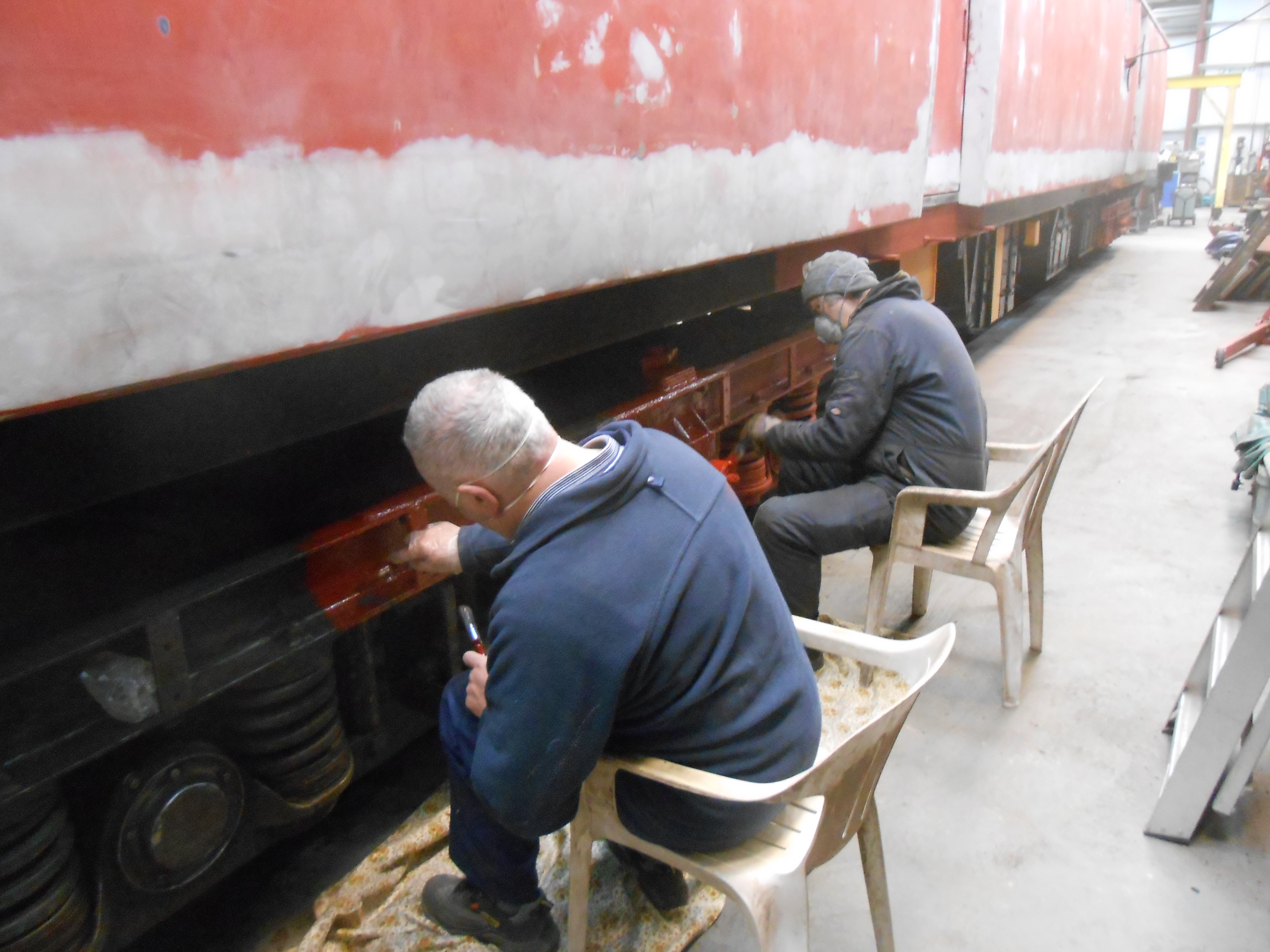 John Davis and Mike Rigg painting one of the TPO bogies