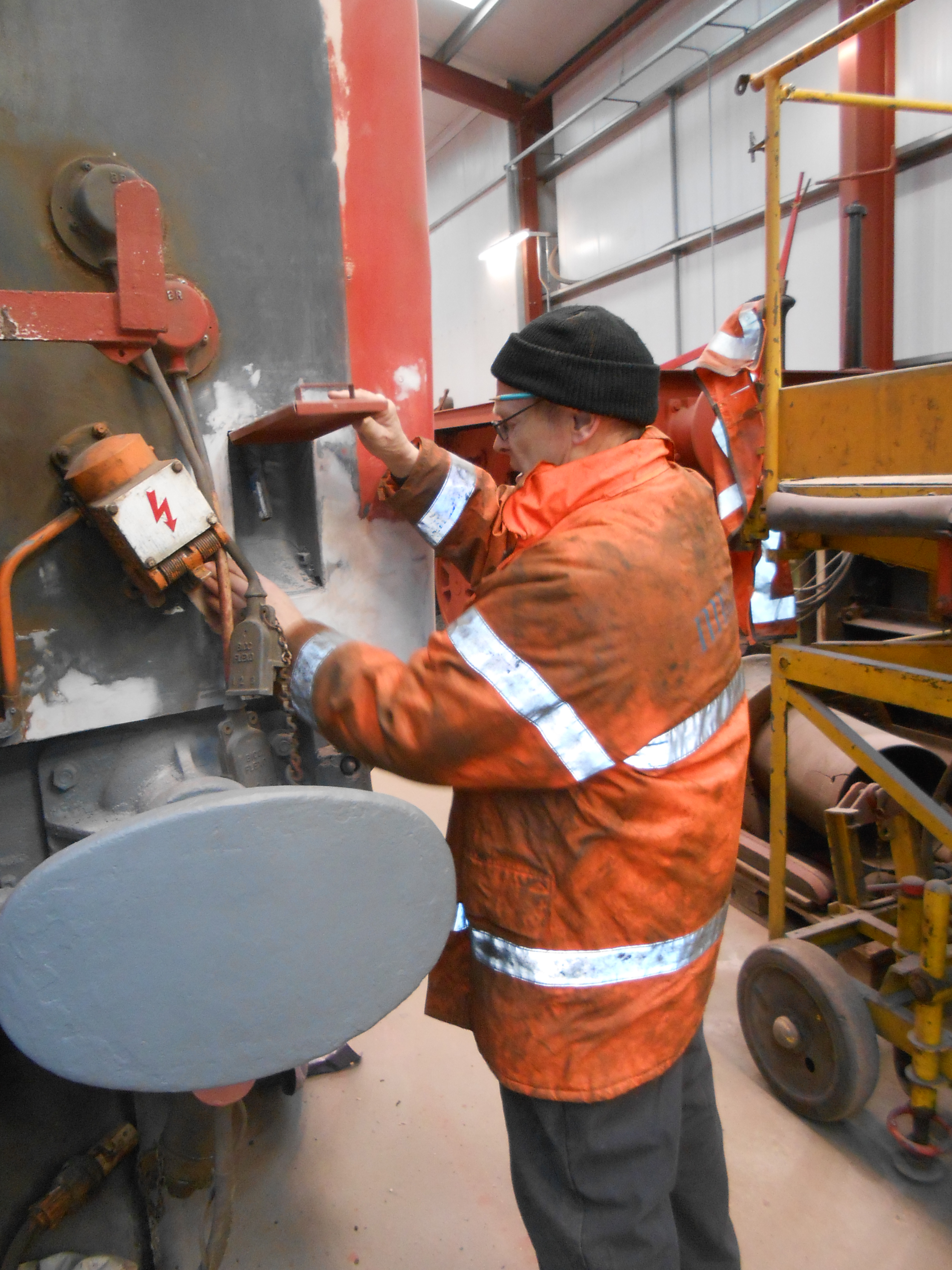 John Dixon preparing the west end of the TPO coach for painting