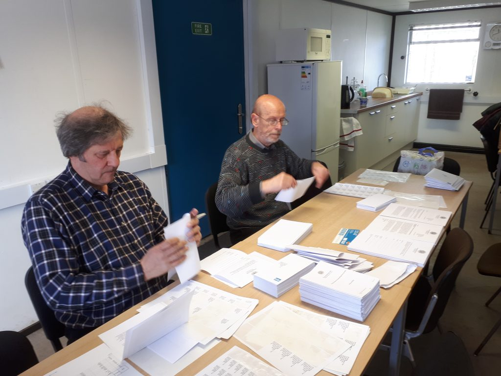 Mike Rigg and David Rimmer hard at it in the mess room stuffing envelopes with the GDPR info