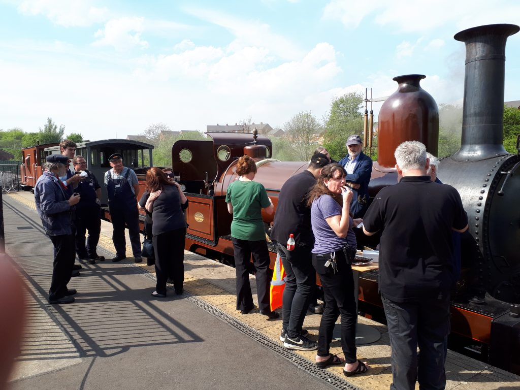 Staff and volunteers at Locomotion attack the cakes before FR 20's final two runs at Shildon on Monday, 7th May