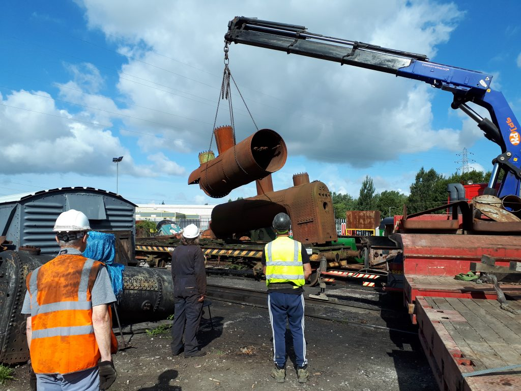 Fr 25's boiler is lifted into position on the FR bogie bolster 010818