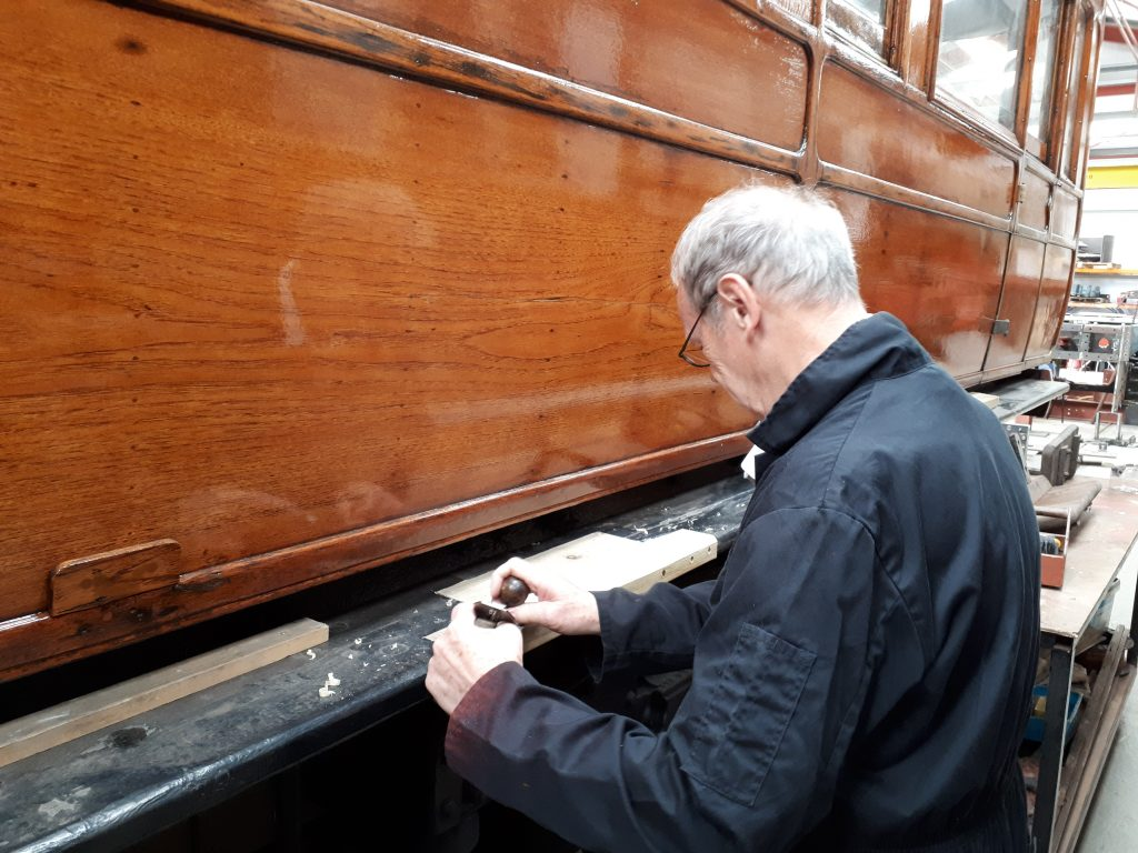 John Dixon panes new wood on one of GER No. 5's step boards