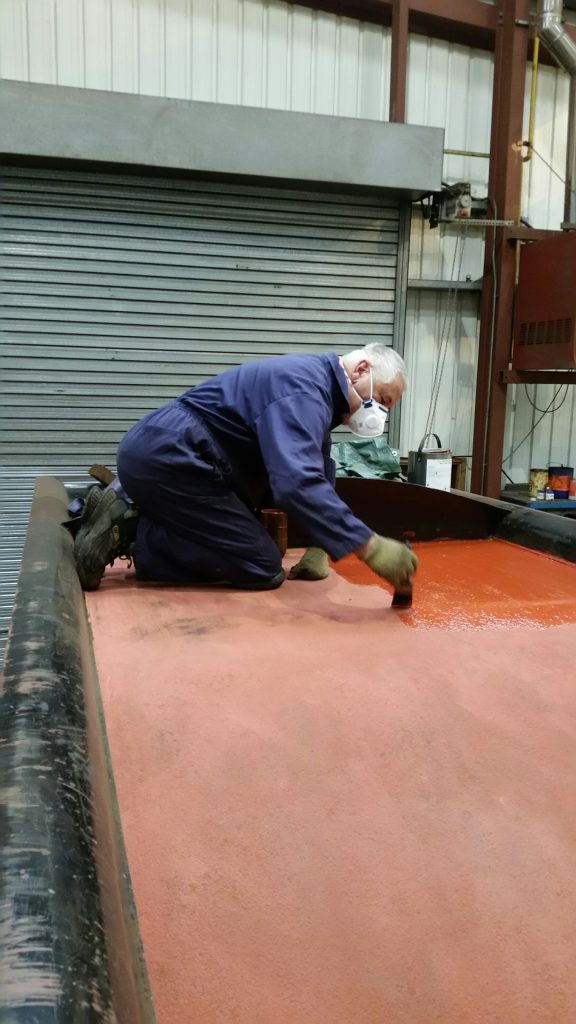 John Davis giving a second coat of primer to FR 20's tender coal space