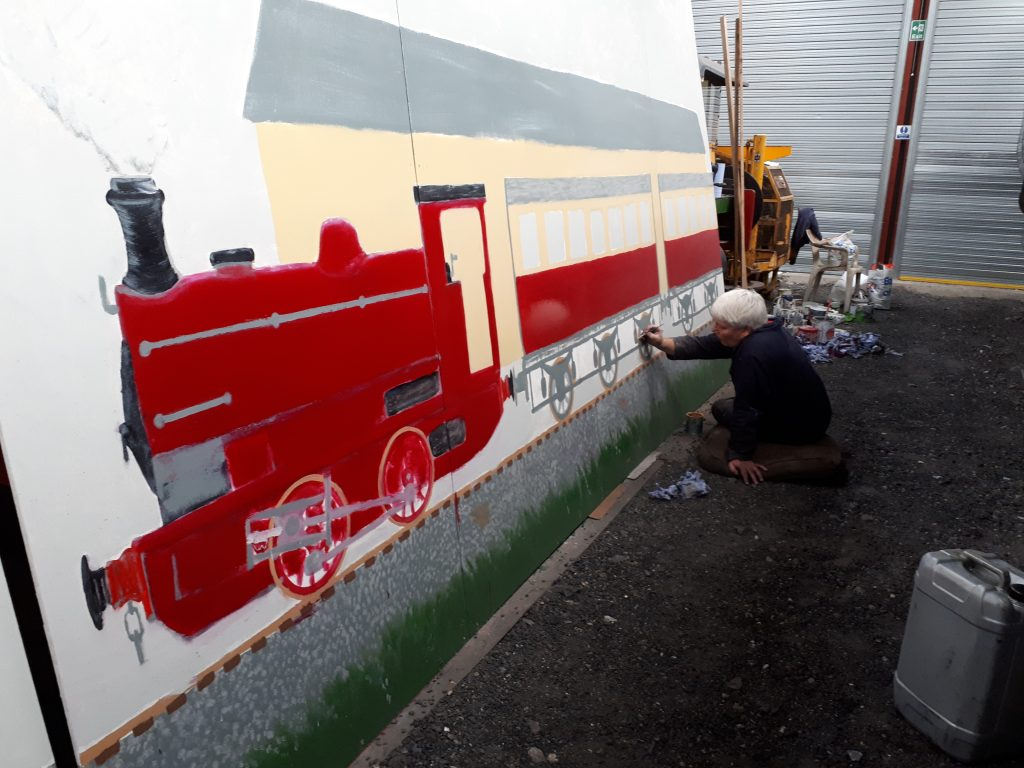 Bill Croston at work on the mural