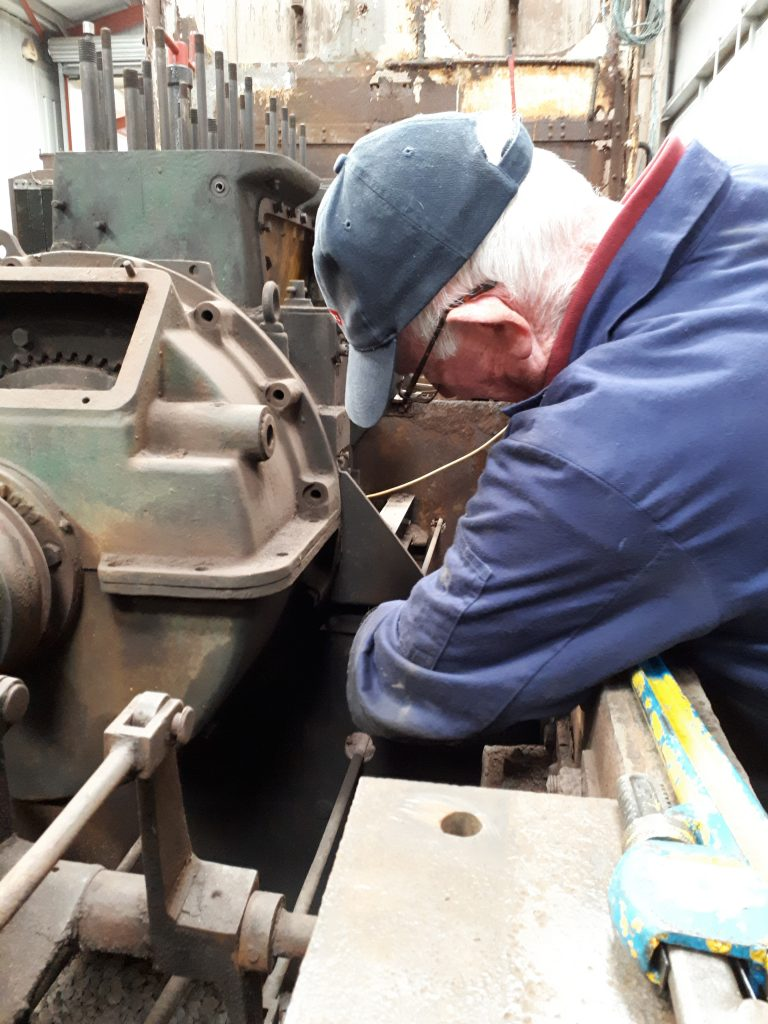 Jim Hanmer removing a bolt holding Fluff's engine