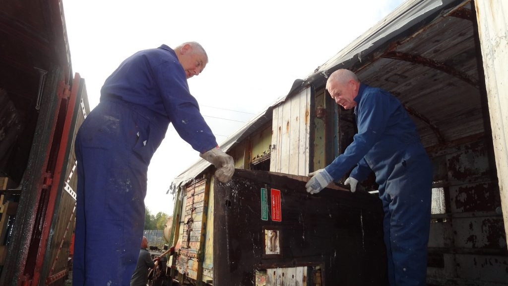 John Davis and Paul Newton emptying the PMV