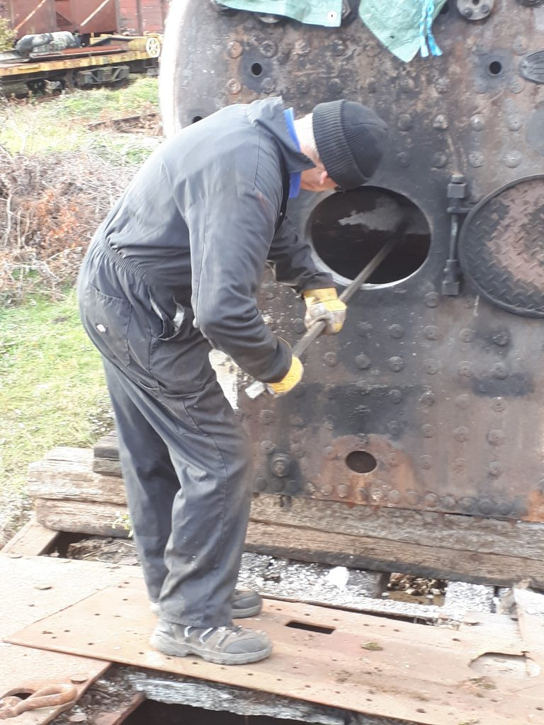 John Dixon prods a stubborn brick arch in FR 20's firebox
