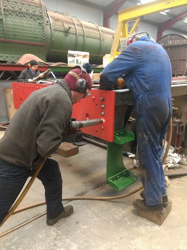 Matt and Keith finish another rivet while John gets the next one ready