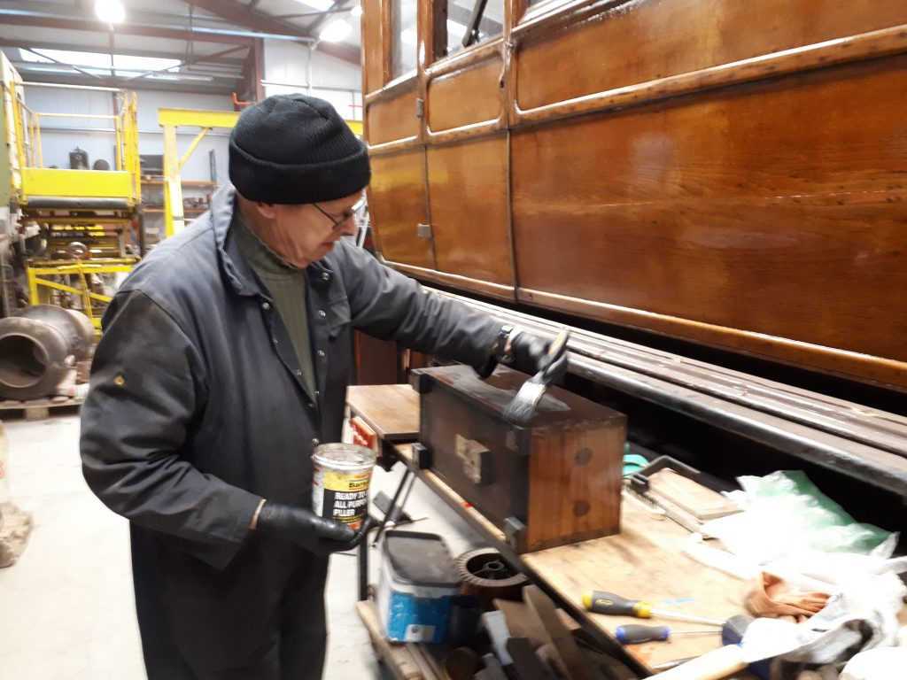 John Dixon cleans oil and grease from FR 20's toolbox
