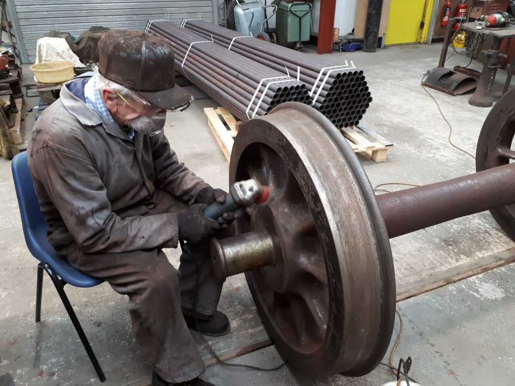 Fred cleans up one of FR 20's tender wheelsets