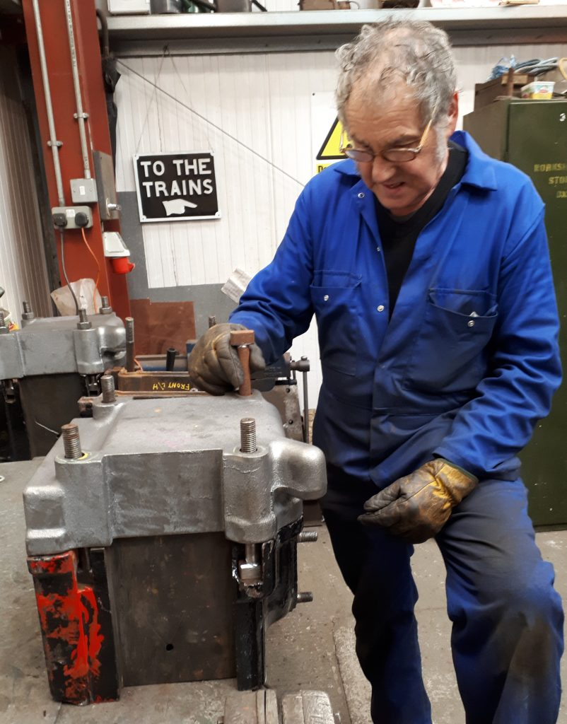 Keith fits one of Wootton Hall's new tender axle box keeps to an axle box