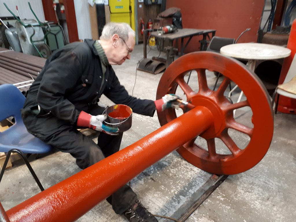 Happy in his work. John Dixon paints one of Fr 20's tender wheelsets