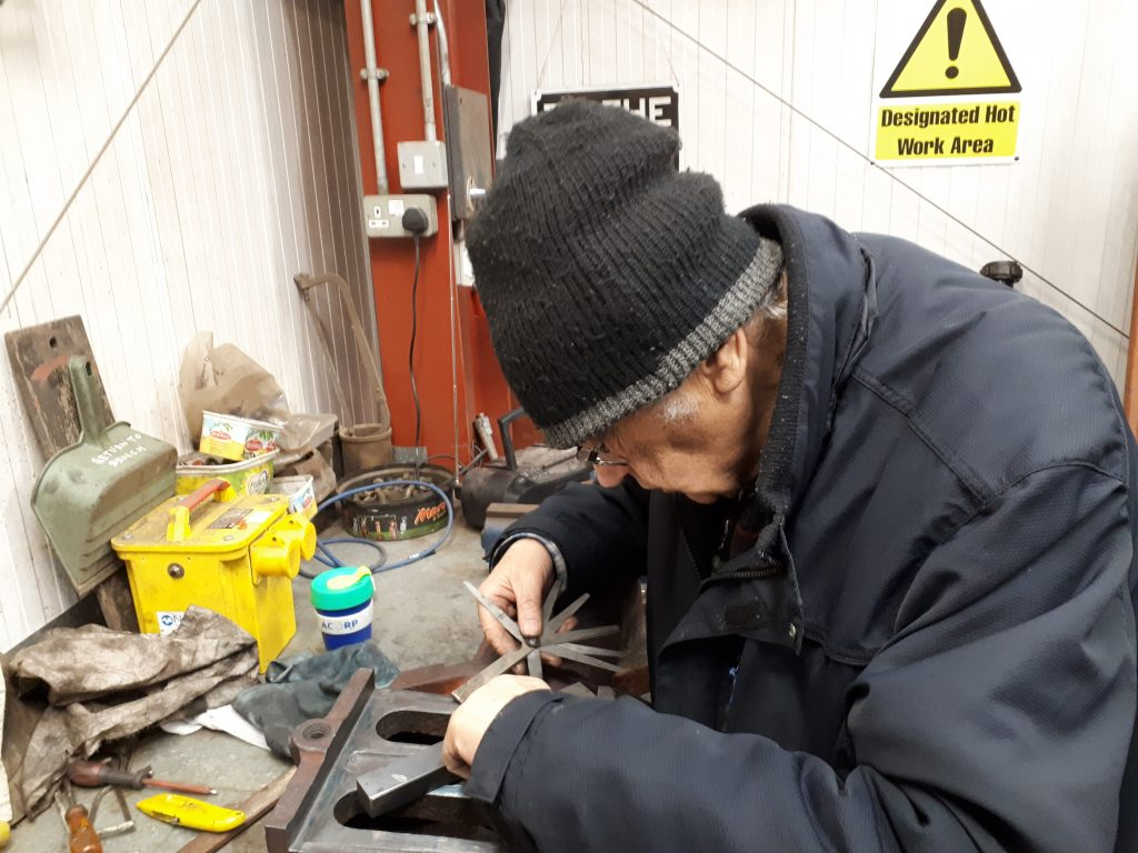 Bob uses a feeler gauge to check progress with work on Cumbria's regulator valve