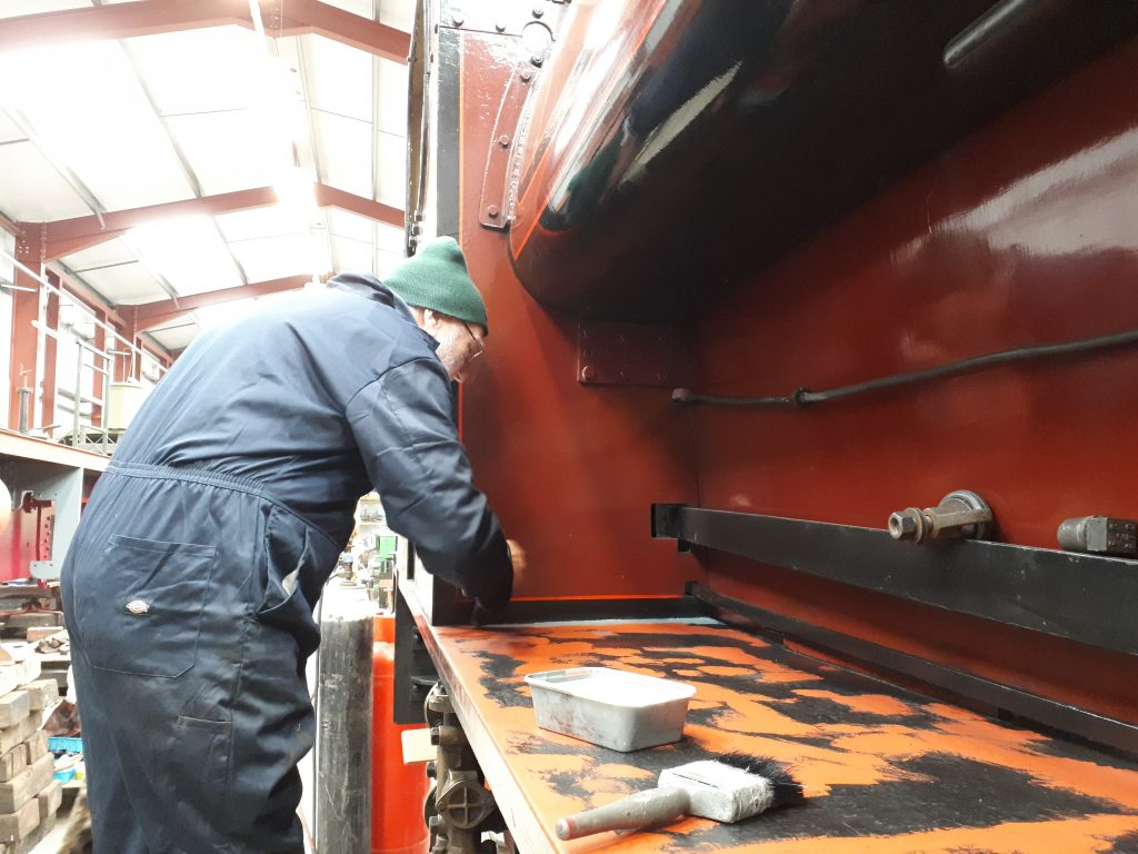 Phil Bell starts the job of undercoating Cumbria's running board