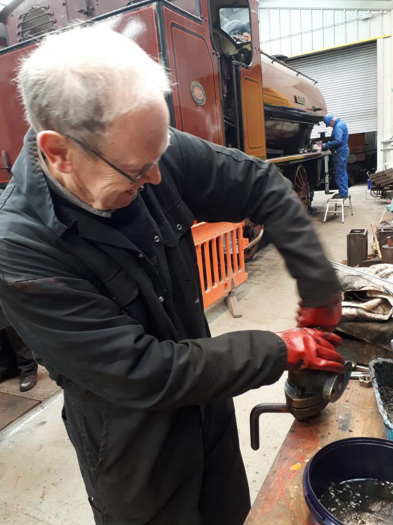 John Dixon gives one of the water valves a good clean