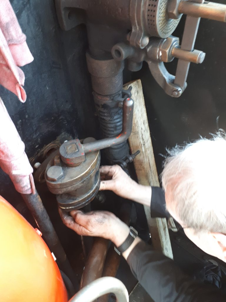 John Dixon fits the drivers side water valve on Cumbria