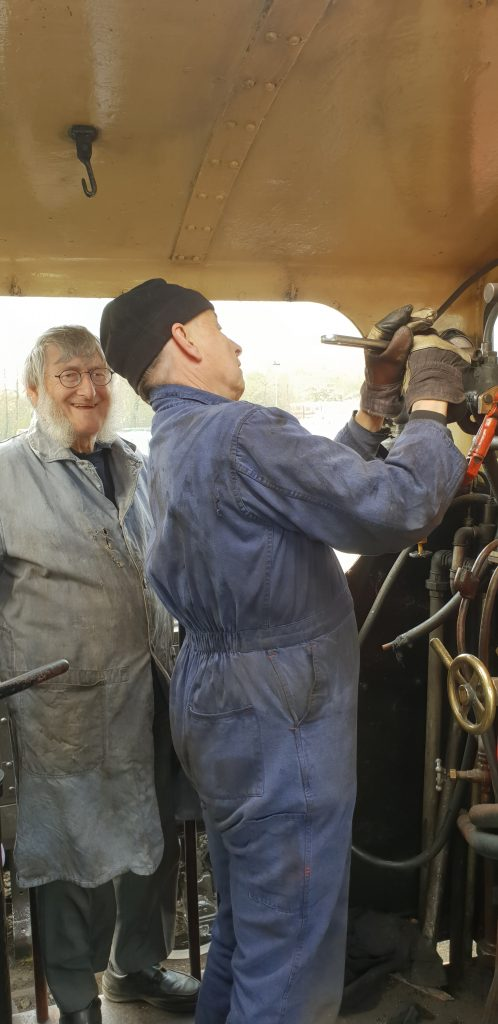 Tim tightens the steam brake pipe to Cumbria's manifold