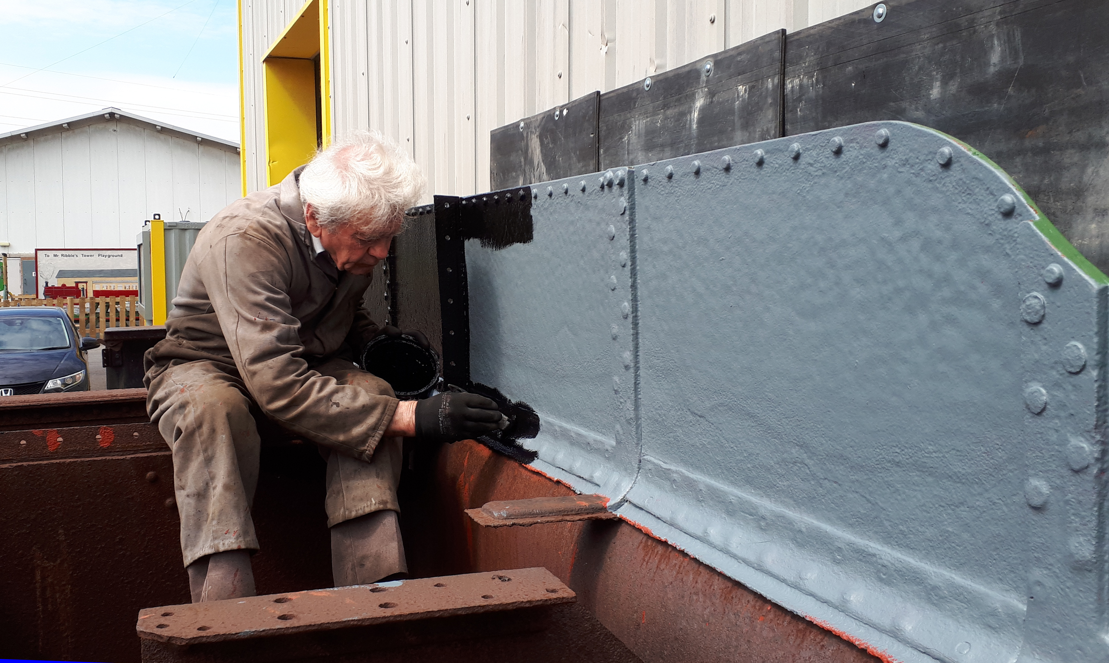 Fred paints the inside of Wootton Hall's new tender tank